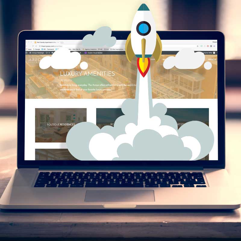 laptop with space ship launching